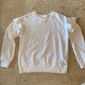 White long sleeve with with ruffled shoulders